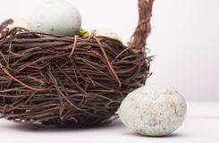 Easter composition with quail eggs in basket on a wooden backrou. Nd. Top view. Holiday card royalty free stock image