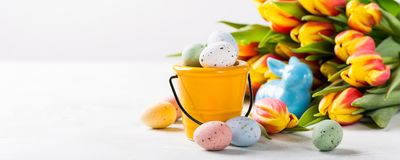 Easter composition with quail eggs and tulips royalty free stock photos