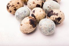 Easter composition with quail eggs on a wooden backround. Top vi. Ew. Holiday card stock images