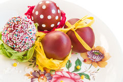 Easter composition in rustic style: colored eggs on vintage plate. royalty free stock photography