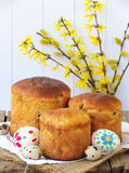 Easter composition of sweet bread, paska, willow twigs and eggs on light wooden background. Orthodox kulich. Holidays breakfast co Royalty Free Stock Photography