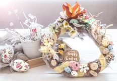 Easter composition wreath. On a wooden background, the concept of Easter holidays royalty free stock photos