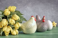 Easter composition with yellow tulips and ceramic hens with East Royalty Free Stock Photo
