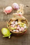 Easter bunny with chocolate eggs Stock Image