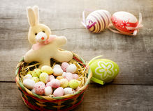 Easter bunny with chocolate eggs Stock Images