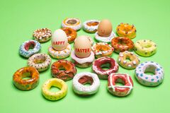 Free Easter Concept. Collection Of Decorative Handmade Ceramic Doughnuts / Donuts And Easter Eggs On Apple Green Background Royalty Free Stock Photo - 173527795