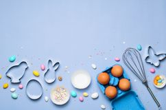 Easter Concept, Cookie Cutters, Eggs, Sugar Sprinkles and Chocolate Eggs on Bright Background stock photography