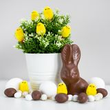 Easter concept - Easter eggs, chocolate bunny, sweets and decorations stock photo