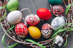 Easter concept .  eggs and wreath on a wooden background Stock Photos