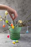 Easter concept. Girl holding colored eggs. Willow branches. Stock Photography