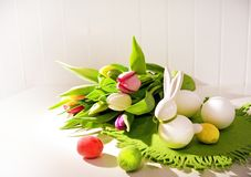 Easter concept, spring tulips and porcelain bunny Stock Photos
