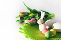 Easter concept, spring tulips and porcelain bunny royalty free stock image