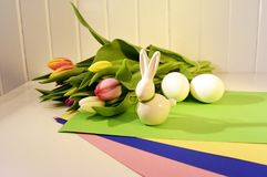 Easter concept, spring tulips and porcelain bunny Stock Image