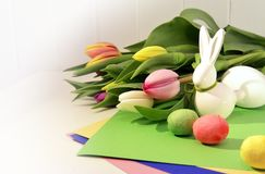 Easter concept, spring tulips and porcelain bunny Royalty Free Stock Photo