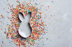 Easter Concept, Sugar Sprinkles and Cookie Cutter on Grey Background. Easter Concept, Sugar Sprinkles and Bunny Cookie Cutter on Grey Background, Sweet Easter royalty free stock image