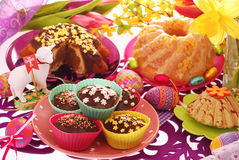 Easter confectionery on festive table. Assortment of easter confectionery ( ring cakes,muffins ) on colorful festive table Stock Photography