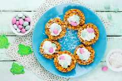 Easter cookie nests with whipped cream and mini egg candy recipe Stock Image