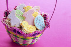 Easter cookies in basket. Mixed Easter cookies in basket with bunnies, lambs, eggs and chicks Royalty Free Stock Image