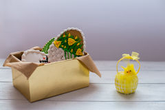 Easter cookies in a box on grey wooden background Stock Photos
