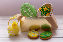 Easter cookies in a box on grey wooden background with chik Stock Photos