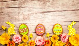 Easter cookies and flowers Stock Photo