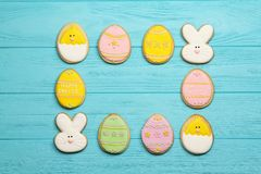 Easter cookies framed on a blue background. Easter cookies with space for text Royalty Free Stock Images
