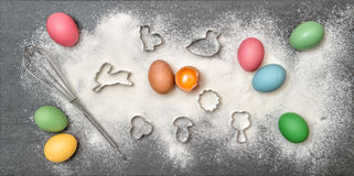 Easter cookies ingredient colored eggs Food background Stock Image