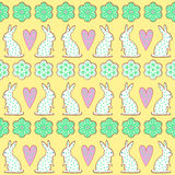 Easter cookies pattern, card - Easter bunny, flowers, hearts on yellow background. Stock Photography