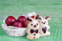 Easter cookies in the shape of hares and colored eggs Stock Photo