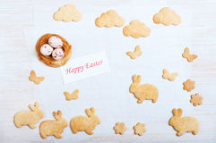 Easter cookies in the shape nest and rabbits Royalty Free Stock Photos