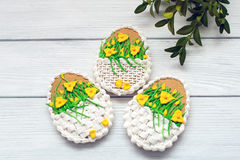 Easter cookies with sword lily and myrtle on grey background Royalty Free Stock Photography