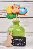 Easter cookies in a vase. Plywood rabbit and greeting card Royalty Free Stock Images
