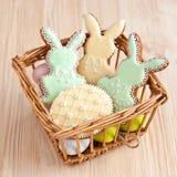 Easter cookies in wicker basket royalty free stock photo