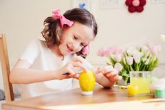 Easter craft with kids - painting eggs at home Royalty Free Stock Image