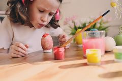 Easter craft with kids - painting eggs at home Stock Images