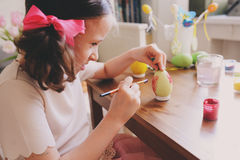 Easter craft with kids - painting eggs at home. Seasonal spring decorations Stock Image