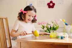 Easter craft with kids - painting eggs at home. Seasonal spring decorations Royalty Free Stock Photography