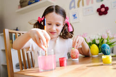 Easter craft with kids - painting eggs at home. Seasonal spring decorations Stock Photo