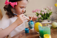 Easter craft with kids - painting eggs at home. Seasonal spring decorations Stock Photos