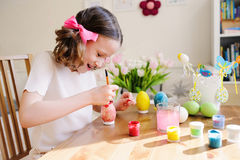 Easter craft with kids - painting eggs at home. Seasonal spring decorations Royalty Free Stock Photo