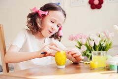 Easter craft with kids - painting eggs at home Royalty Free Stock Images