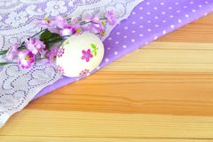 Decoupage Easter egg, natural wooden background Stock Photo
