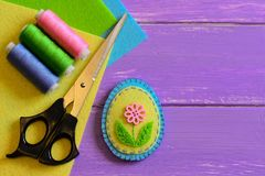 Felt Easter egg decor with flower. Easy Easter crafts for kids. Hand sewing crafts idea. Materials and tools for doing felt Easter. Easter crafts for kids. Fun royalty free stock photography