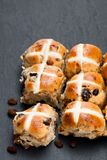 Easter cross buns and sultanas on black stone background Stock Photos