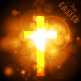 Easter Cross on a golden glowing background with text Royalty Free Stock Photo