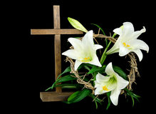 Easter cross and lilies. Easter cross with crown of thorns and white lilies Royalty Free Stock Photos