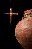 Easter cross and wine jug Stock Images