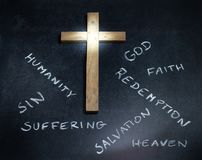 Easter cross and words on blackboard abstract religion concept. On dark background Royalty Free Stock Image