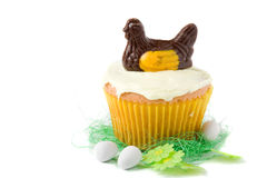 Easter cupcake. Delicious easter cupcake with a chocolate chicken on top Stock Photos