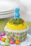 Easter cupcake. Angel food cupcake with vanilla frosting decorated with a candy bunny Stock Photos